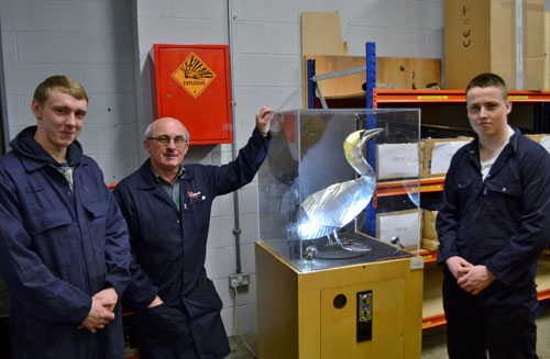 Daniel Dewar, Terry Healy and Sean Devine with the robotic bird