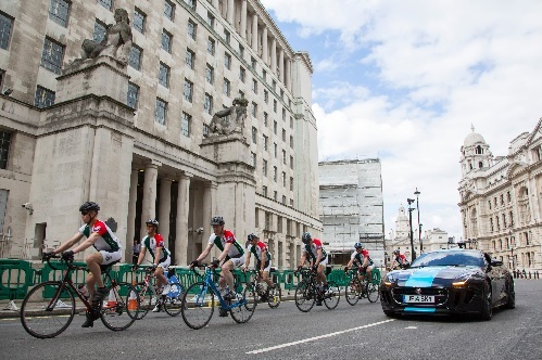 Cyclists leave Ministry of Defence and get on their way to Guildhall accompanied by Jodie Kidd in the Team Sky Jaguar F-TYPE Coupé