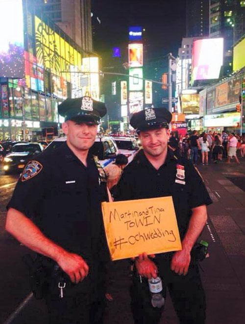 Cops in New York have been snapped holding a sign