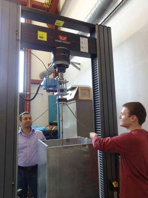 Researchers carrying out model screw pile tests