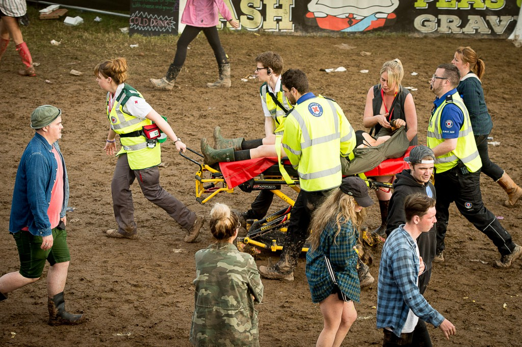 T in The Park, 2015, Day Three. T in The Park has it's first day on it's new site at Strathallan Castle. Thousands of festival goers brave the rain to attend the 22nd TiTP. IN PIC................. A female reveler is stretchered to the medical tent. (c) Wullie Marr/DEADLINE NEWS For pic details, contact Wullie Marr........... 07989359845