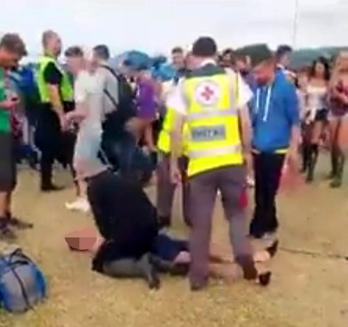 He is dragged off the tent and pinned to the ground
