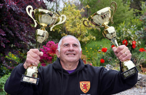 Pensioner David Hearn, from Skye, has become a world weightlifting champion in his category. The 75-year-old managed his achievement despite having a bad back. He has converted his garage in the main town of Portree into a weightlifting gym.