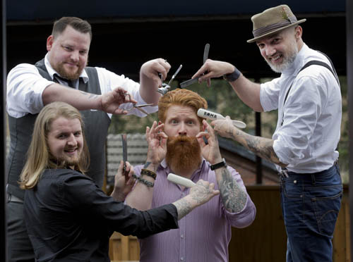 FREE PICS GREAT BRITISH BARBER BASH: BEARD & MOUSTACHE EVENT HEADS TO GLASGOW'S EAST END  Promising a 'buzzing event' from start to finish, the Great British Barber Bash heads to Glasgow on Sunday 26th July.  Staged at Drygate Craft Brewery in the city's East End, the event will attract the best barbers from across the country in a bid to showcase their flair for hair, moustaches and beards. Set to become a key date in Scotland's barbering calendar, the event is geared to bring together this unique community for a day of inspiration, trend spotting and, of course, beard appreciation.   Drygate brand ambassador, Chris Moriarty poses while being preened by a selection of barbers from Sunday's event .