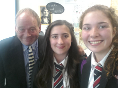John Lloyd pictured with pupils at the High School.