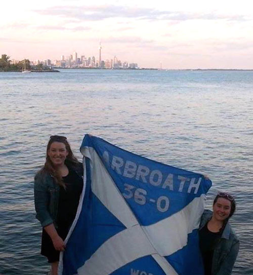The hostesses with the flag and Toronto in the background
