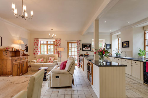 The kitchen/dining area forms the hub of the home