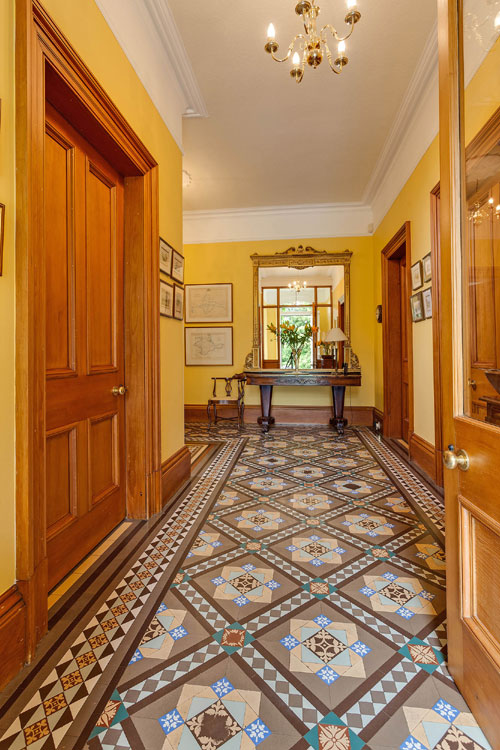 The mosaic floor in the hallway makes it a feature in the house