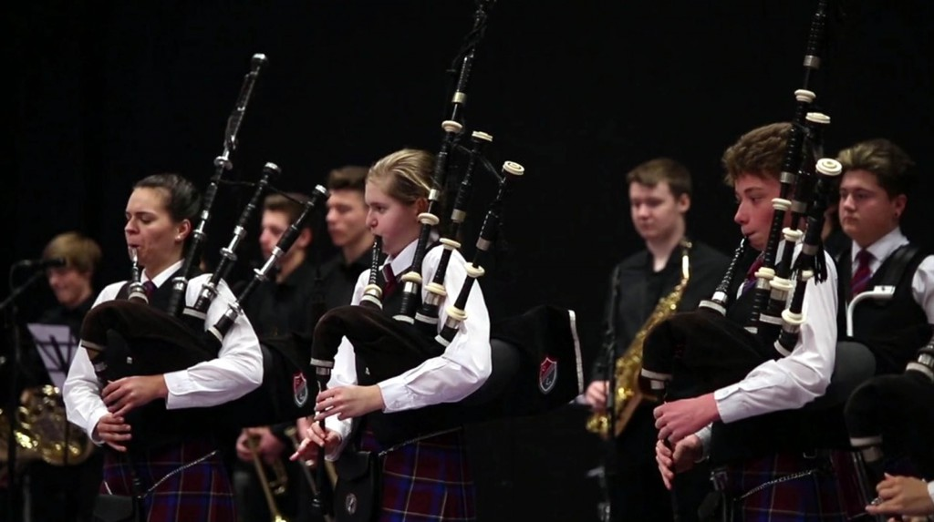 Children playing alongside other instrumentalists at the school's Championships this year