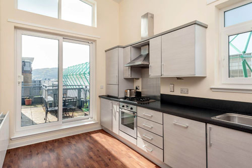 It boasts a modern kitchen which opens onto a private balcony