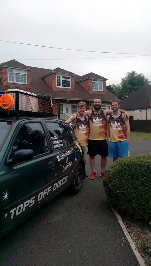 The trio with their car at the start of the journey
