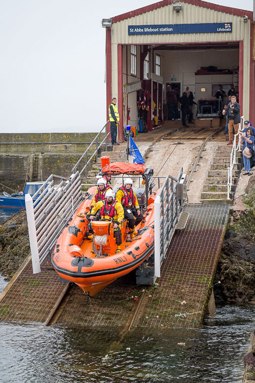 The lifeboat is lowered down the slipway for the last time