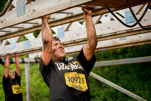 The monkey bars were a tough challenge for all competitors