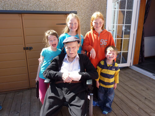 With his four grand-children