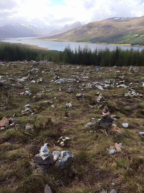Mini cairns built above Loch Loyne in the Highlands