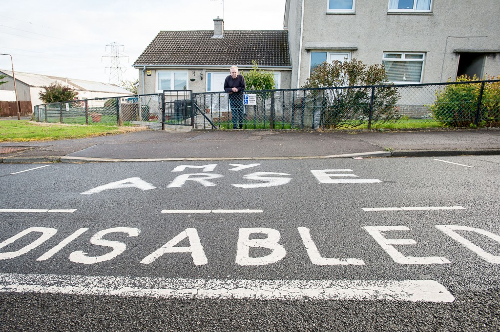 Vandals have painted a derogatory  slogan on the disabled parking space outside the home of Alexander Bagg and his partner, Pauline Caswell, in Forthview Crescent, Currie. IN PIC................. Alexander Bagg (c) Wullie Marr/DEADLINE NEWS For pic details, contact Wullie Marr........... 07989359845