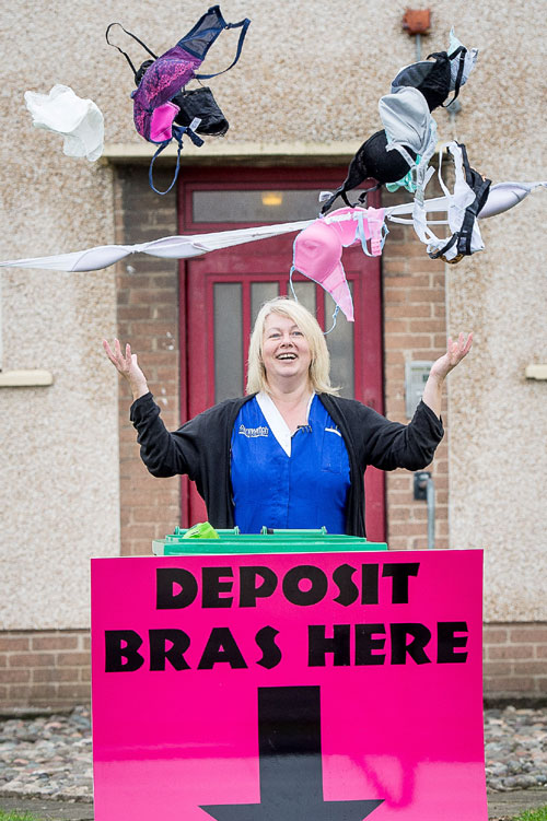 Angela showing her delight at the bra deposit