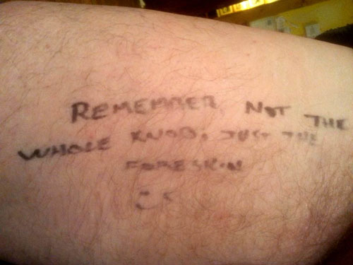 The note which Sandy wrote on his thigh