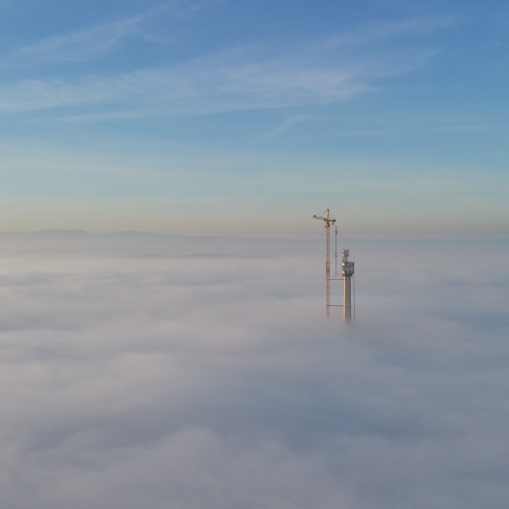 The south tower poking through thick fog