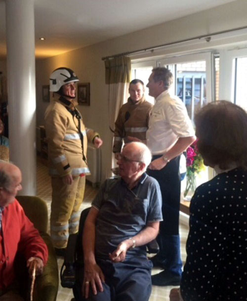 Nairn tweeted this picture showing him in discussion with two firefighters