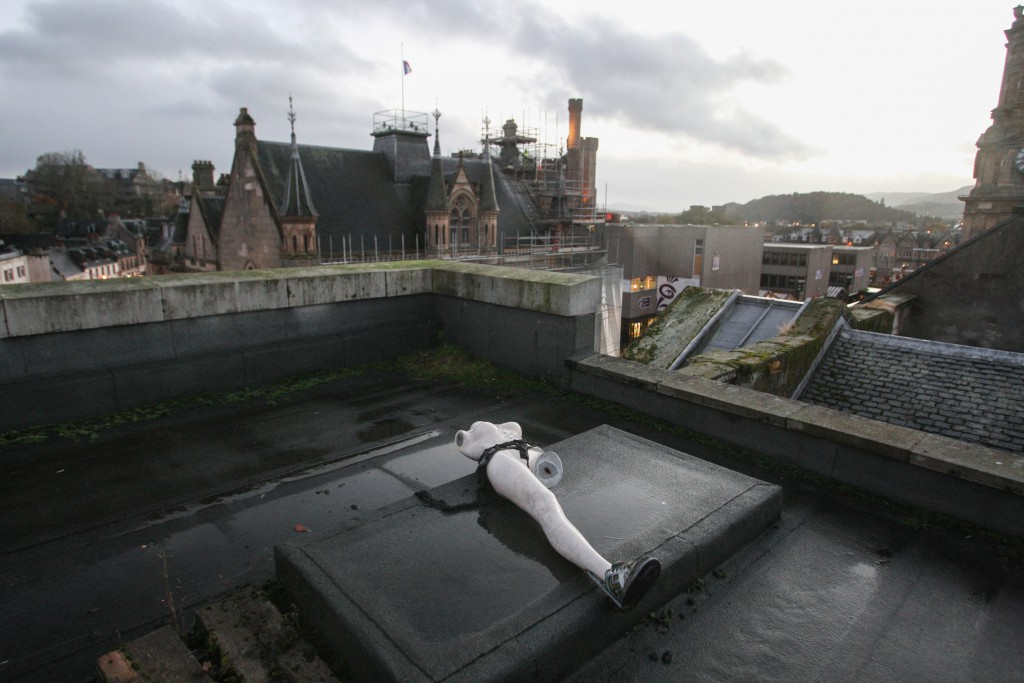 A mannequin on the roof of the old Woolworths building in Inverness, where Poundland now has a store. The manager of the Poundland store, Kenny, thinks the mannequin has been there since Woolworths closed in 2009. Picture: Andrew Smith