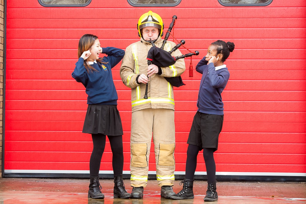 ***FREE FIRST USE PICS*** A charity appeal is being made for old bagpipes to be donated to give new young players a better chance in life. A piping trust is giving free tuition to more than 1000 pupils in schools across Scotland Ð many in the most deprived areas Ð and need instruments for the youngsters to play. IN PIC................. Firefighters, Steven Walls, tries his hand at the pipes as Yin Chen, and Savannah Batchelor from Riverside school, show their thoughts on his playing, at Govan Fire Station (c) Wullie Marr/HPR For pic details, contact Wullie Marr........... 07989359845