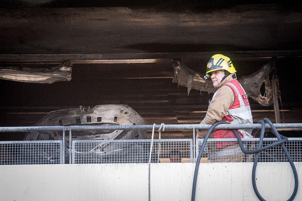 A fireman surveys the scene