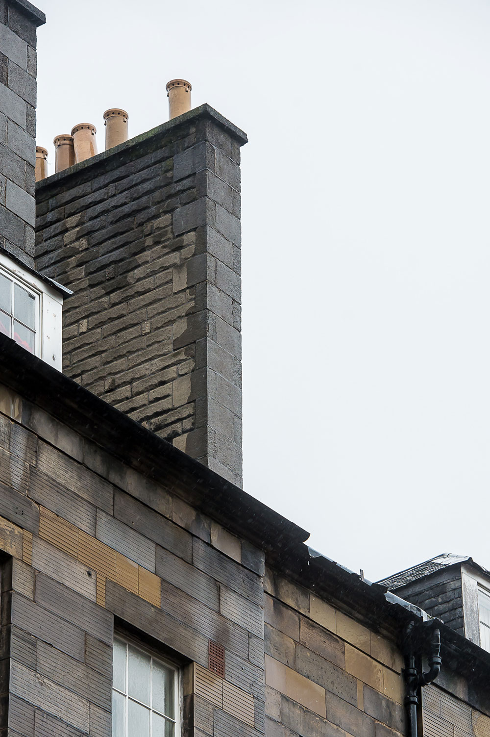 The 2-ft tall chimney pot hit a double decker