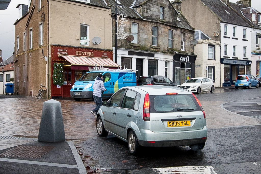Kinross Main Street has had a £1.5m revamp, with mixed reactions. IN PIC................. A driver has to brake sharply as a pedestrian uses the 'shared space' section (c) Wullie Marr/DEADLINE NEWS For pic details, contact Wullie Marr........... 07989359845