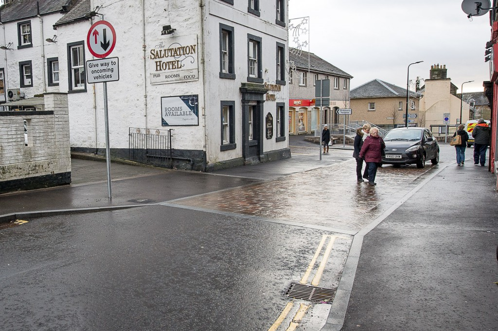 Kinross Main Street has had a £1.5m revamp, with mixed reactions. IN PIC.................At the point where the Main Street's ONLY official pedestrian crossing was, pedestrians and cars vie for the space at the new 'courtesy crossing' where neither knows who has a right of way. (c) Wullie Marr/DEADLINE NEWS For pic details, contact Wullie Marr........... 07989359845