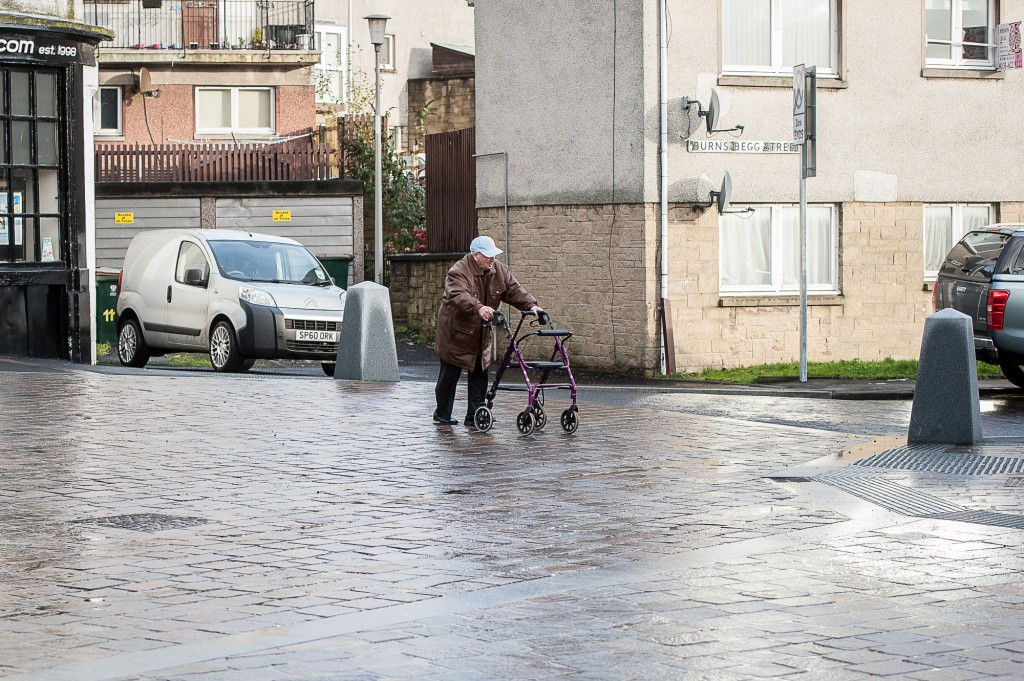 Kinross Main Street has had a £1.5m revamp, with mixed reactions. IN PIC................. An elderly infirm gentleman crosses the road without any safety measures in place. (c) Wullie Marr/DEADLINE NEWS For pic details, contact Wullie Marr........... 07989359845