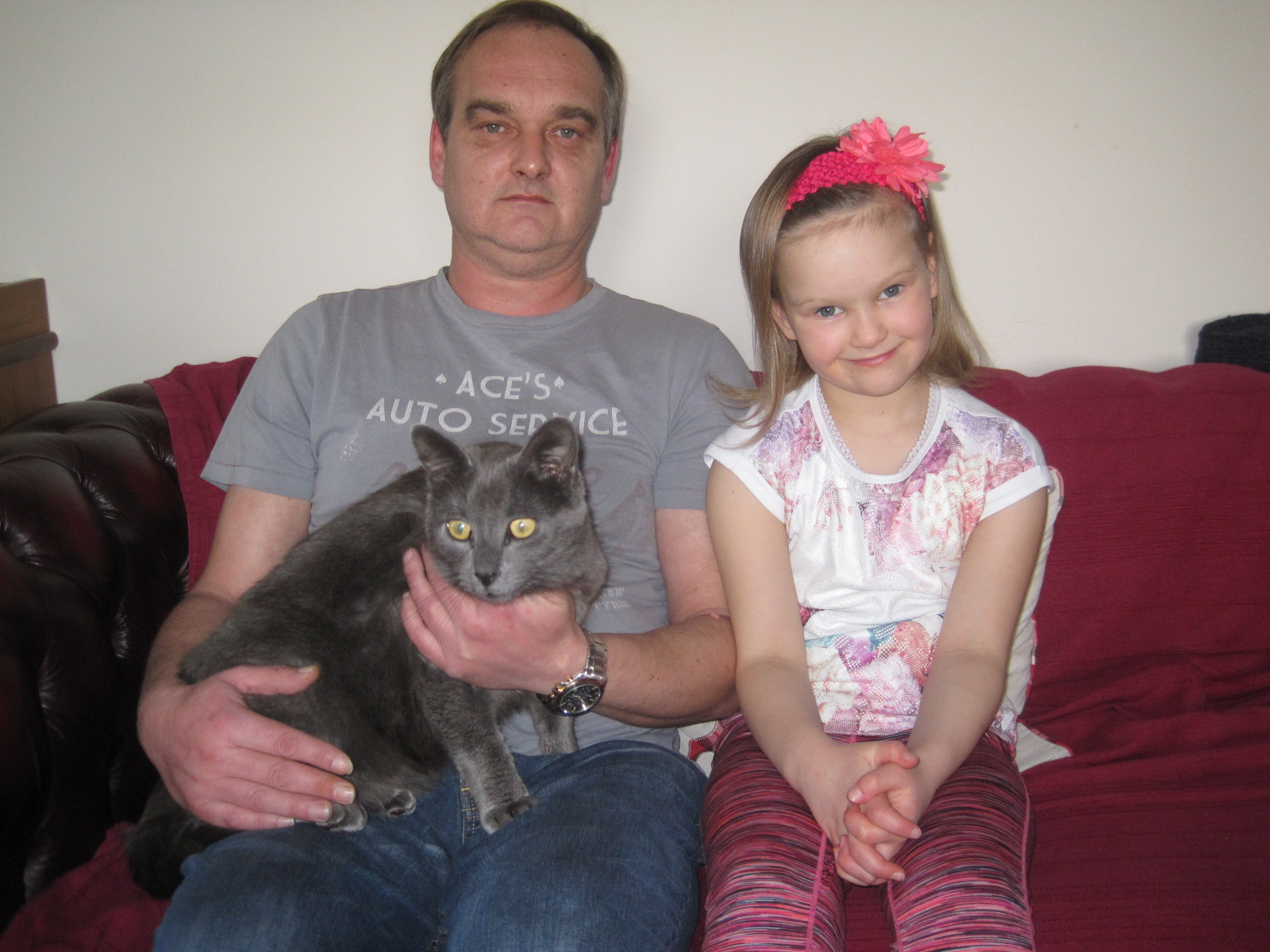 Bill the cat with owner Scott MacEachern and his daughter Rose