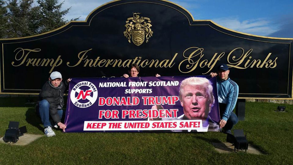 Three men posed next to the sign at the golf course