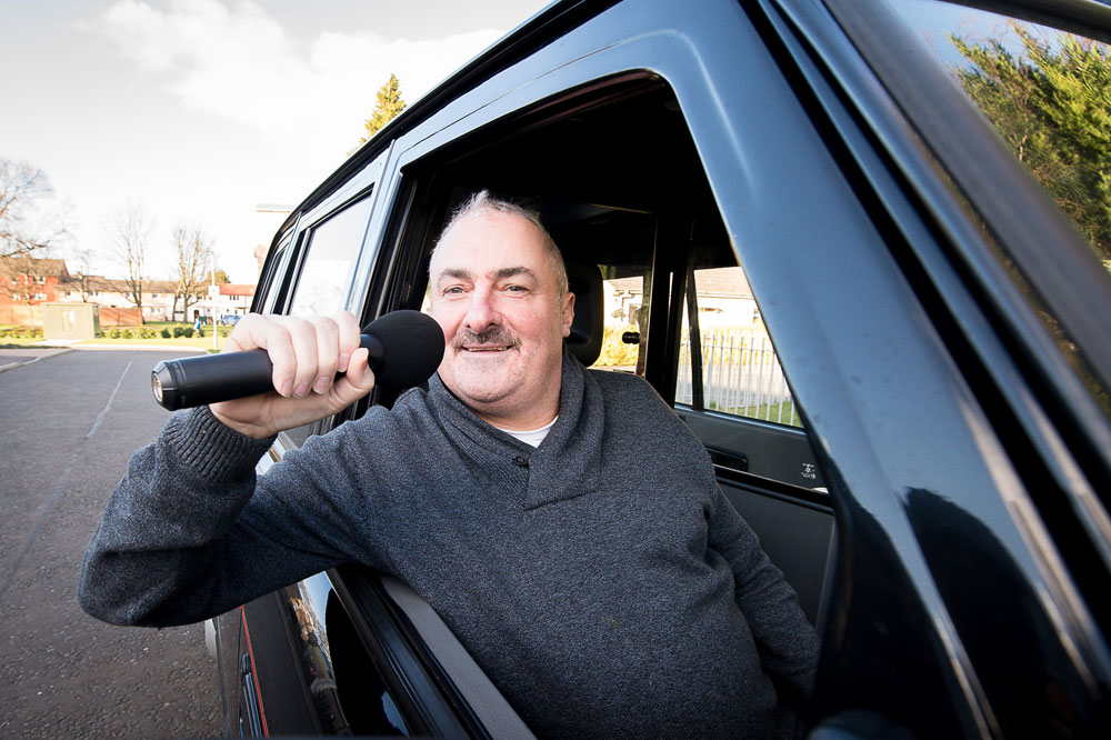 Brian Mitchell has been revealed as the singing taxi driver