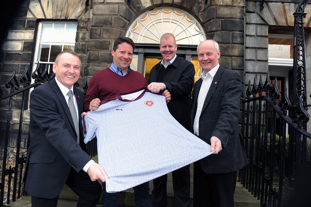 4/02/2016 Former Hearts Manager Paulo Sergio with his presentation Foundation of Hearts Shirt during his visit to the capital to take in the William Hill Scottish Cup Fifth Round tie with Edinburgh Rivals Hibernian on Sunday 7th Feb 2016. L/r Foundation of Hearts Chairman Brian Cormack , & fellow Directors Garry Halliday & Alastair Bruce with Paulo Sergio Pic Eric McCowat