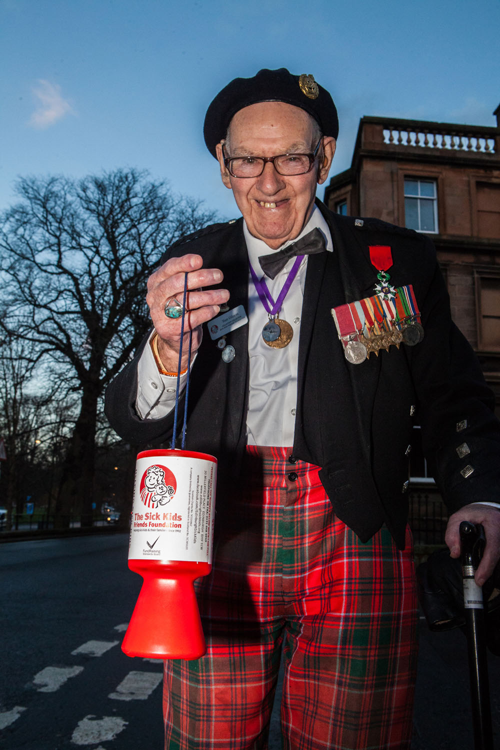 Edinburgh-born war veteran Tom Gilzean (95) has been helping to raise money on the streets of Edinburgh for The Sick Kids Friends Foundation for 33 years. And now needs help to repair his wheelchair so he can continue his charity work. IN PIC (LtoR) Tom Gilzean