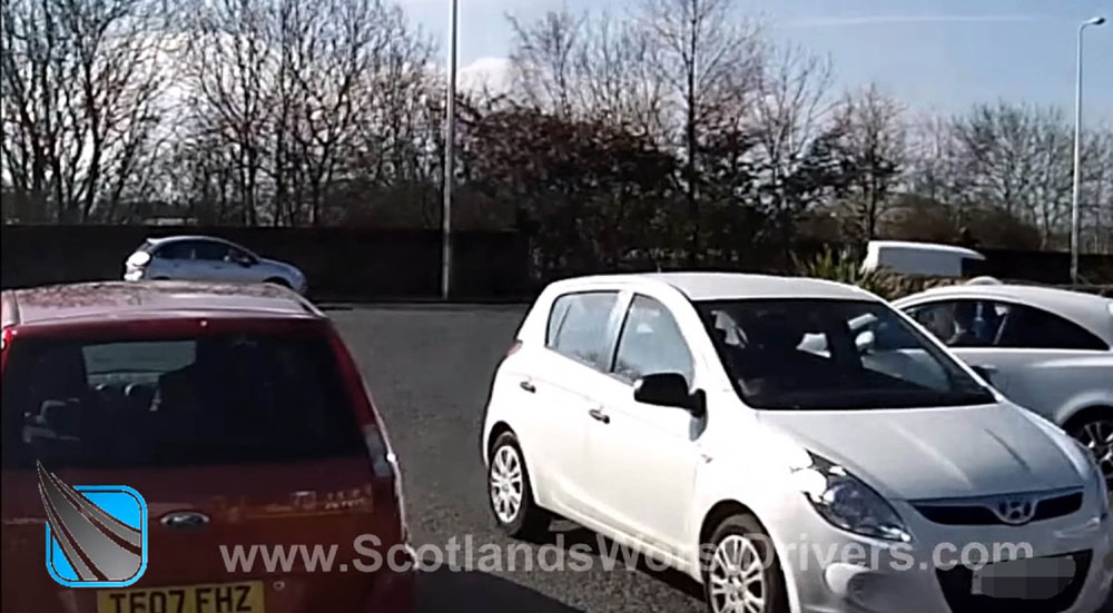 The driver left the roundabout by driving down a 'no entry' slip road