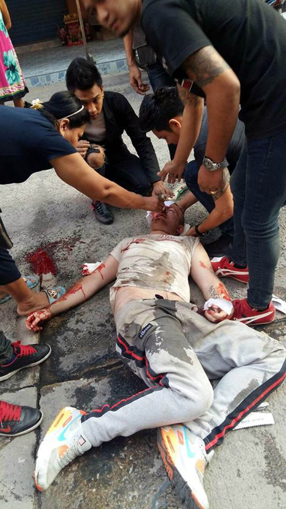 Paul was pictured lying on the ground covered in blood