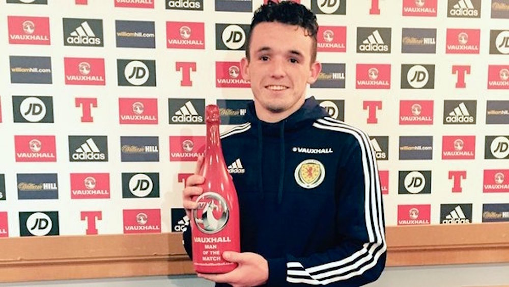Mcgann with his man of the match champagne (Pic: Scottish FA)