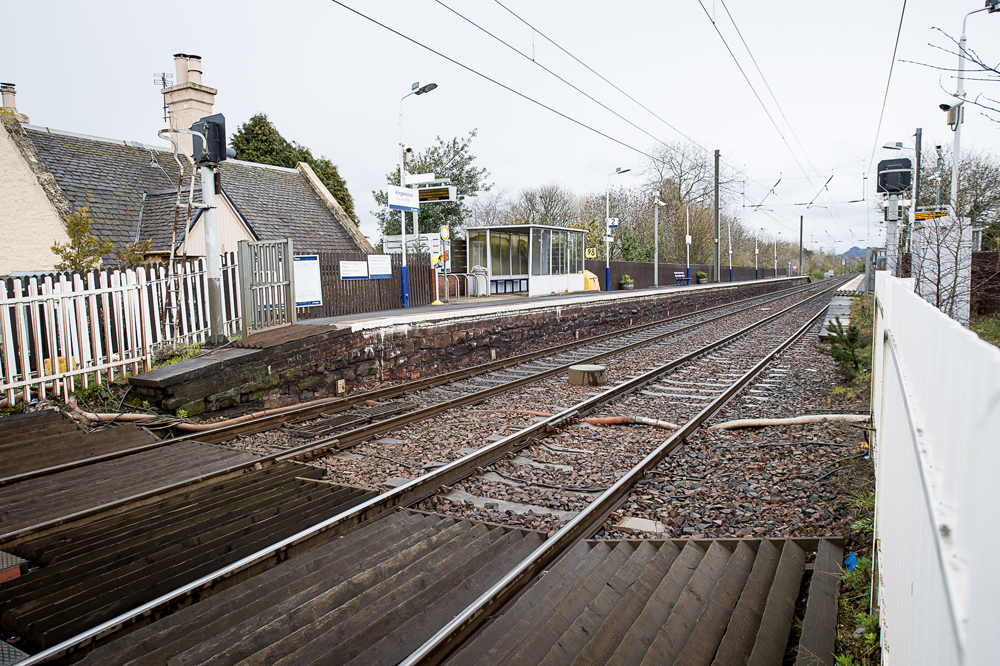 A THREE year old boy ran along one of Scotland's busiest railway lines for half a mile after getting off a train without his parents. The toddler jumped off the Glasgow to Edinburgh train in Wester Hailes and was left behind on the platform. IN PIC................. Kingsknowe train station (c) Wullie Marr/DEADLINE NEWS For pic details, contact Wullie Marr........... 07989359845