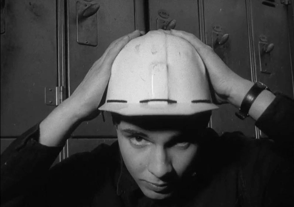 A young Jonathan Aitken tries on a helmet