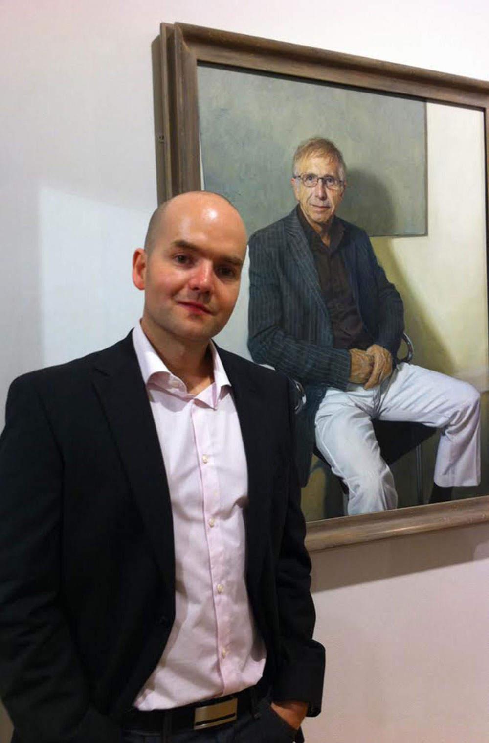 Mark next to his award-winning portrait of Dr Archie Brain
