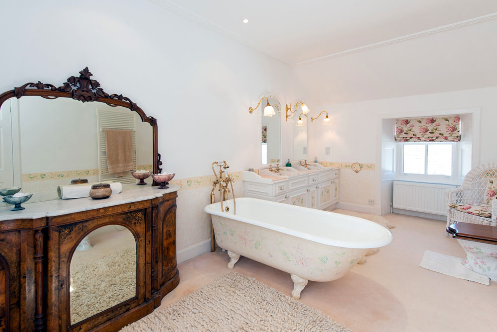 The impressive bathroom with stand alone bath