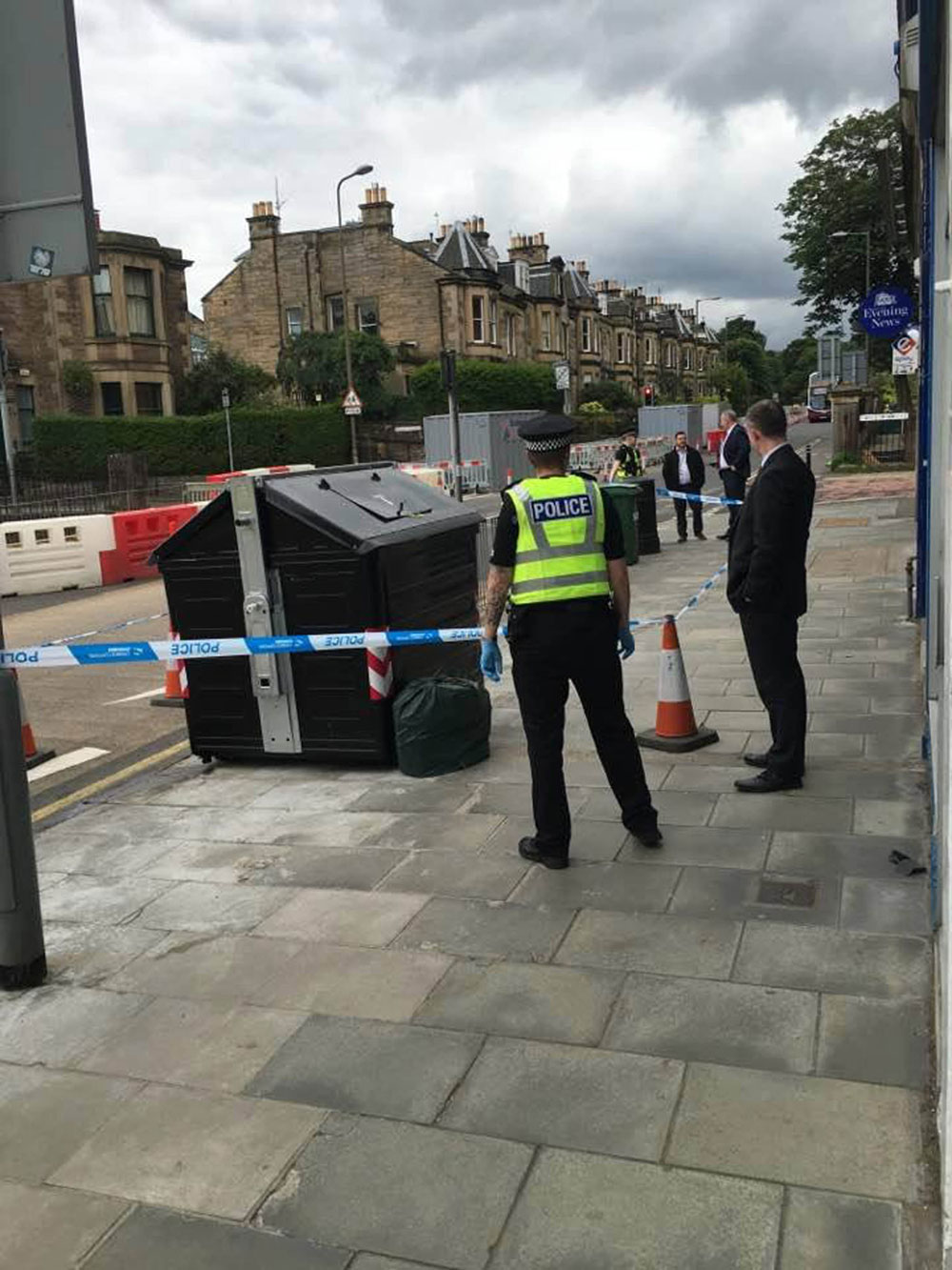 Police surrounding the bin (PIC: comiston.co.uk)