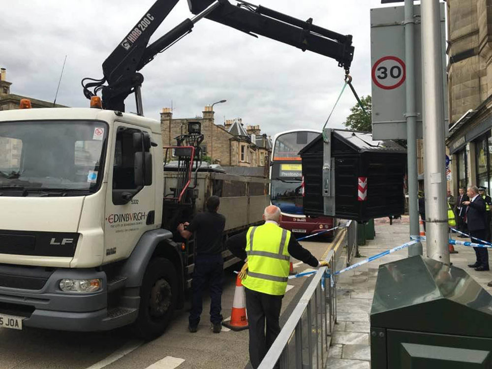 The bin being removed for examination (PIC: comiston.co.uk)