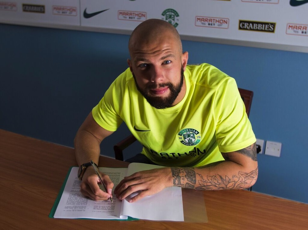 Jordon Forster signs