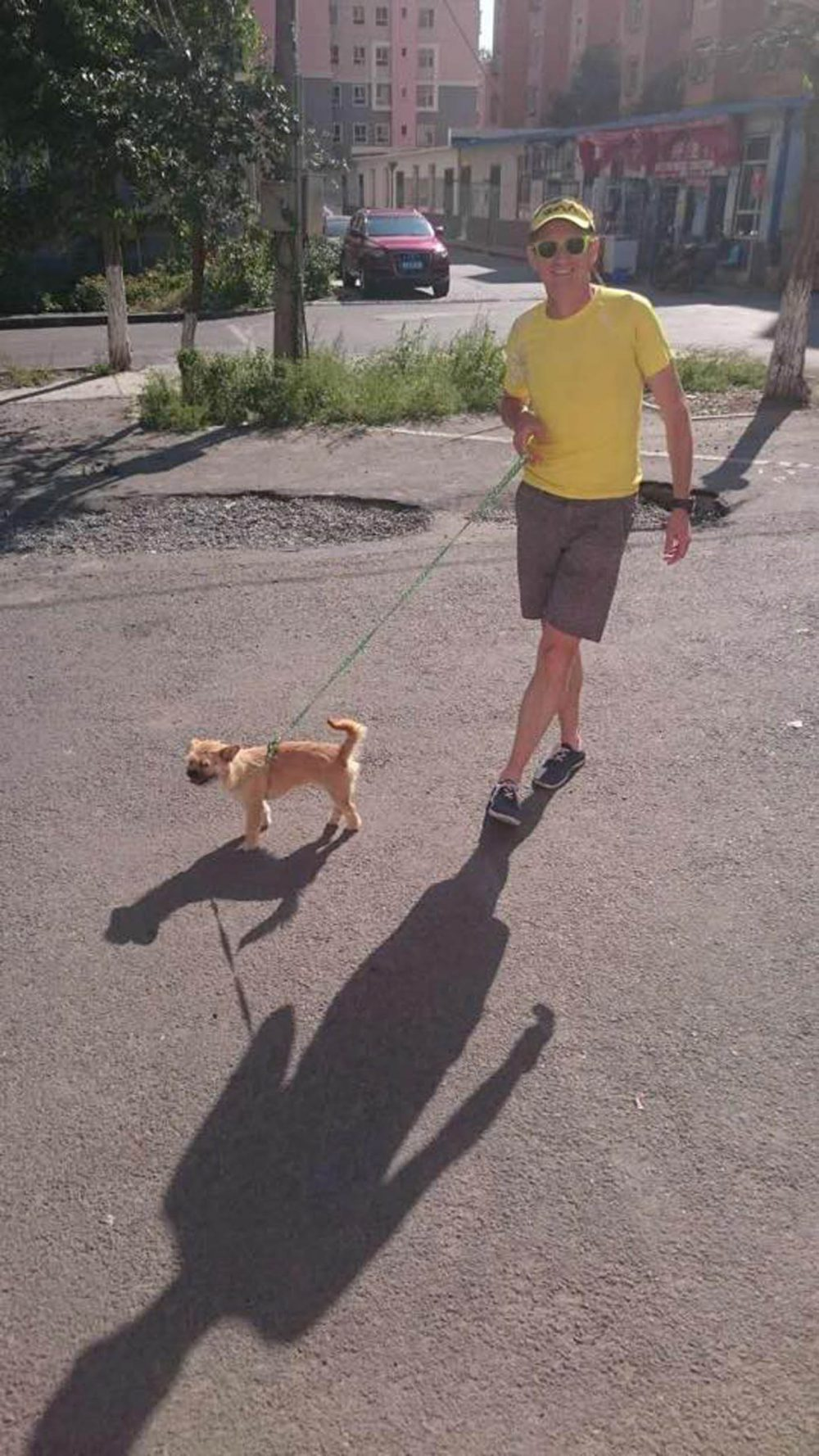 Dion and Gobi take their first walk after they were reunited - with the dog now firmly tethered A HEARTWARMING video shows the moment Gobi the missing dog was reunited with the runner who wants to give him a new home in Scotland. Stray pup Gobi had been lost in Urumqi, China for over a week ago after running off just days before she was due to begin her journey to Britain. Athlete Dion Leonard planned to adopt the lovable pooch and bring her back home to Edinburgh after the pair struck up an unlikely friendship. The inseparable pair became the stars of a Gobi desert marathon after being spotted running alongside each other during the gruelling 250km marathon in June. But in a remarkable turn of events, the four legged friend went missing eight days ago when she ran out of an open door while being looked after at a friends house. At that point, almost £10,000 was raised to help Dion and volunteers search for the pup. Dion, 41, flew back to China last week to head up the search. But last night (WED) after eight days on the run, a video was shared showing the twosome finally reunited and sharing their first moments together.