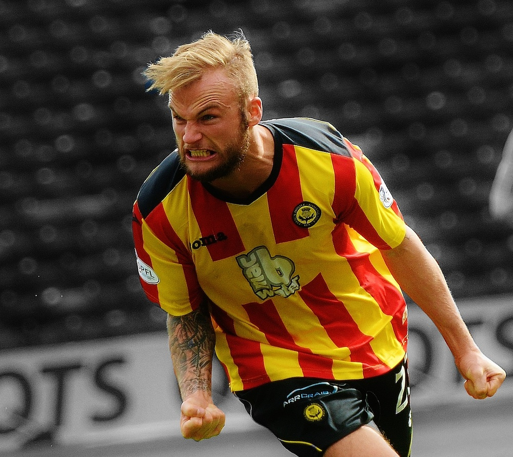 Higginbotham in action for Partick Thistle (Pic: Donaldlaboo)