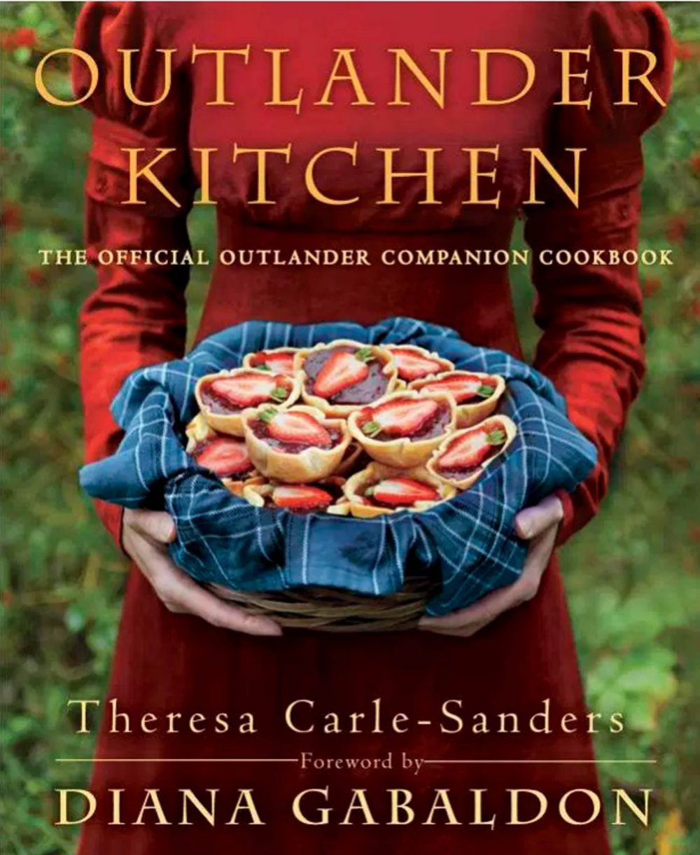 "AN Outlander cook book has been ridiculed after featuring 18th Century Scottish classics such as tacos, fried chicken and enchiladas Outlander Kitchen is billed as the official companion to the hit drama series in which a Second World War nurse is transported to Highland Scotland in 1743. While the book features classic several Scottish dishes, the Canadian author has filled out the volume with  north American recipes such as ""Maple Pudding"", ""Apple Fritters"" and ""Sweet Potato Pie"". Theresa Carle-Sanders explained that readers did not want to eat 18th Highland dishes every day. But Scottish chefs have hit out at the £25 hardback, which uses American phrases such as ""mom"", and have accused Carle-Sanders of selling out. One particular recipe, for cheese enchiladas, a dish that originated in Mexico, tells the reader to add ""red chile peppers to taste"" and ""kosher salt"". It also recommends that the person cooking the dish uses El Pato (corr) brand tomato sauce."