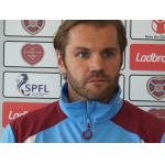 Robbie Neilson in blue and maroon tracksuit   Hearts News